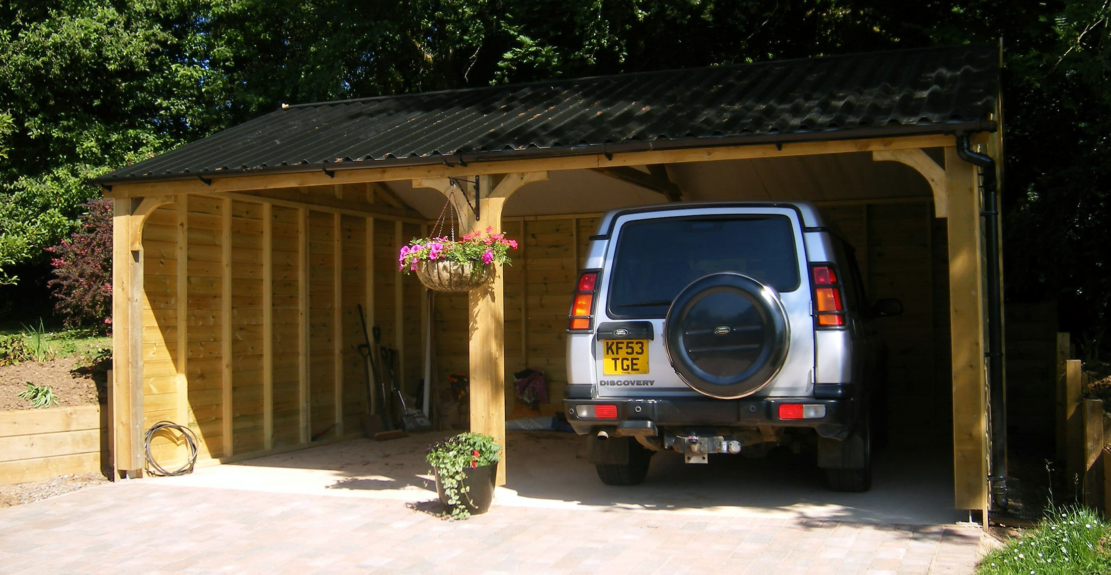 Open fronted wooden garage