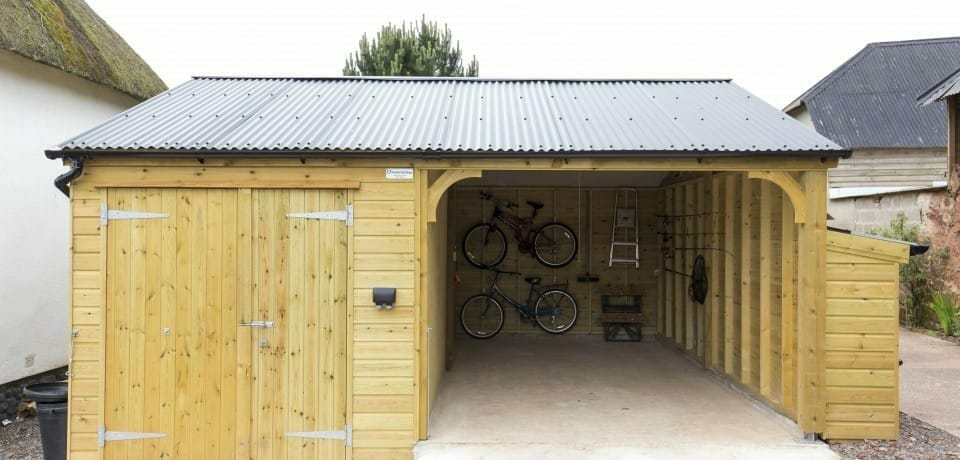Bespoke multipurpose log store, carport and workshop building