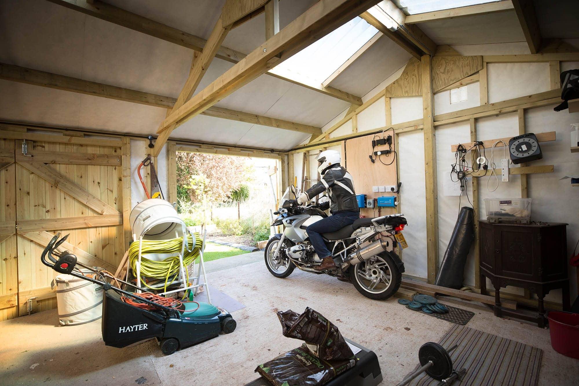 Interior of wooden garage with barn doors.