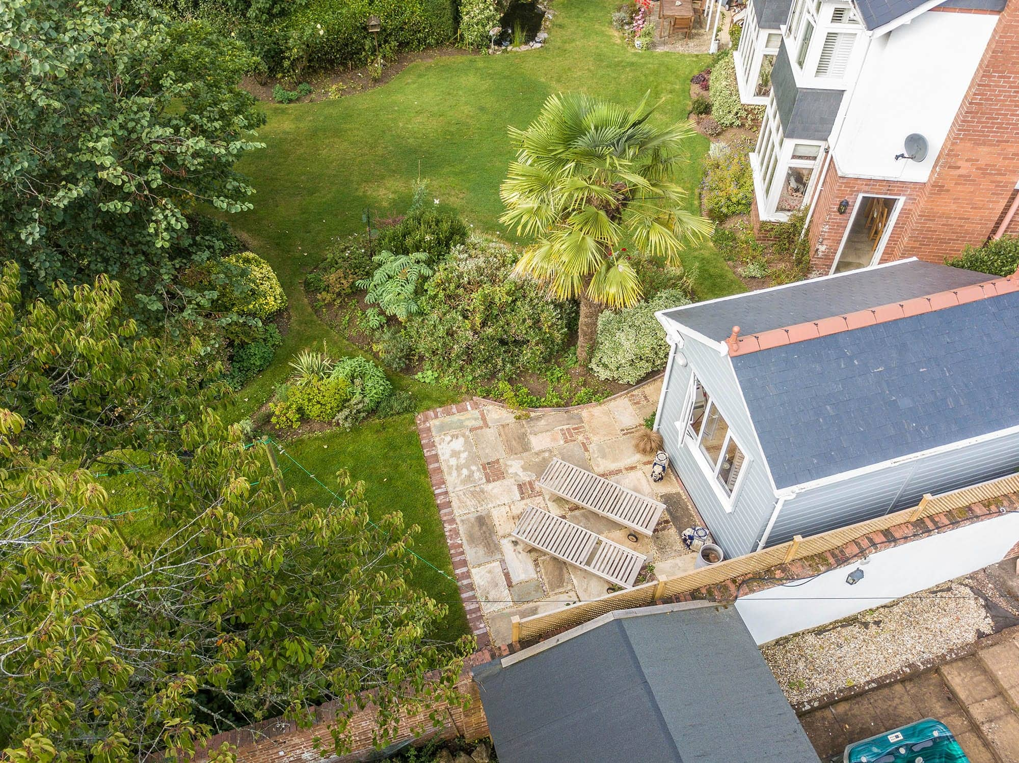 Aerial view of timber frame artist studio with slate roof