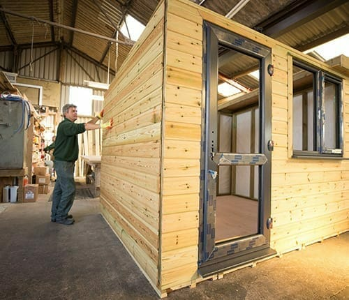 Each timber building is prepared in our workshop.