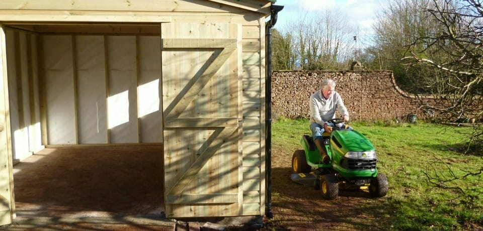 Garage for ride on mower