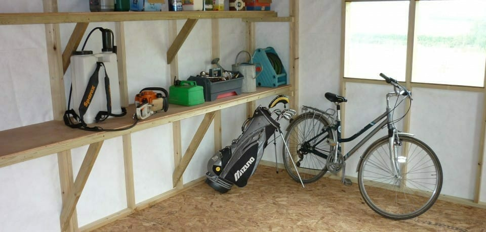 Large wooden storage shed with built in shelving