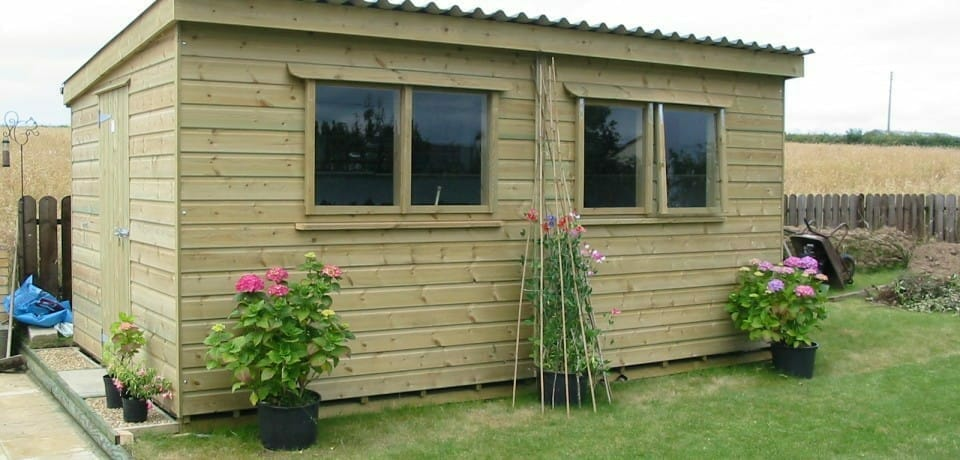 Garden building with natural wood finish