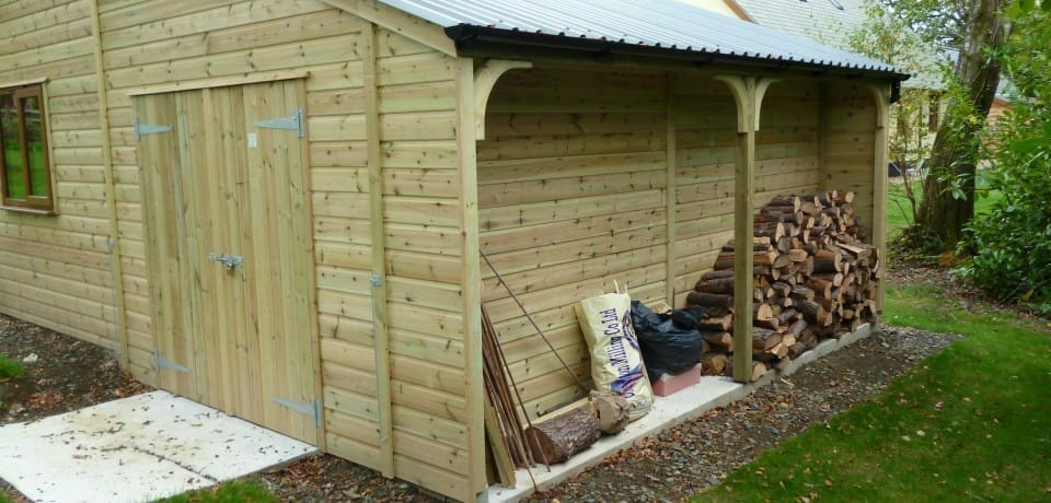 Shed with lean to log storage attached