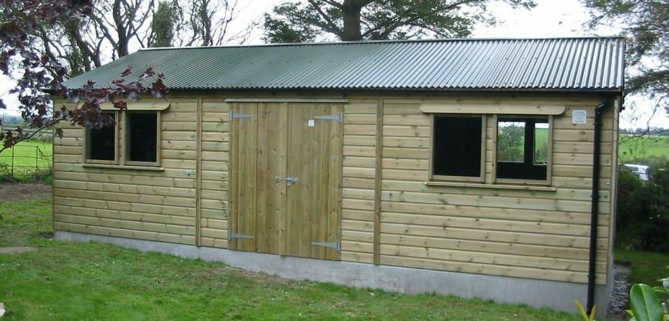 Timber clad workshop on concrete base