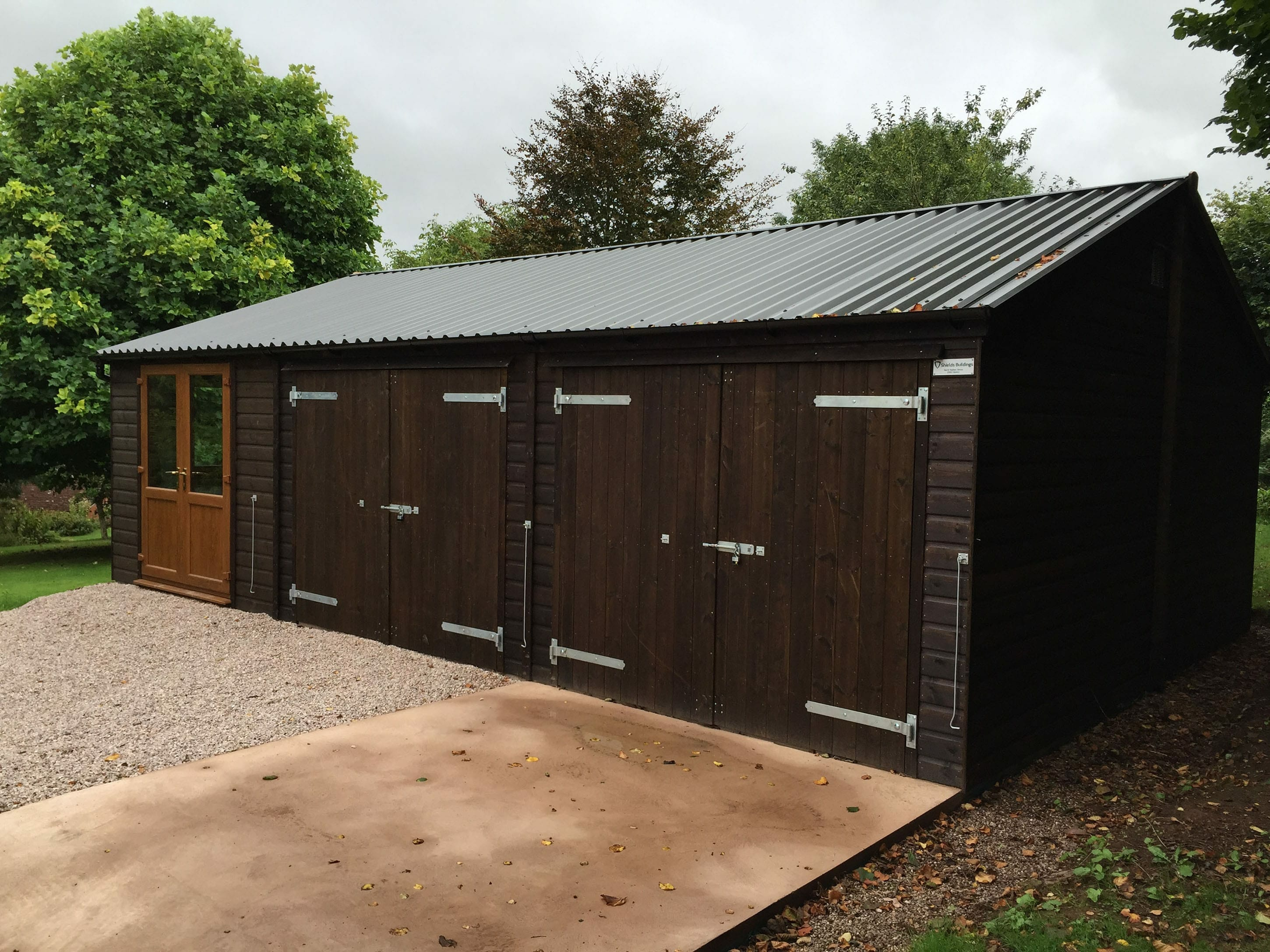 Dark stain combination office, storage and garage.