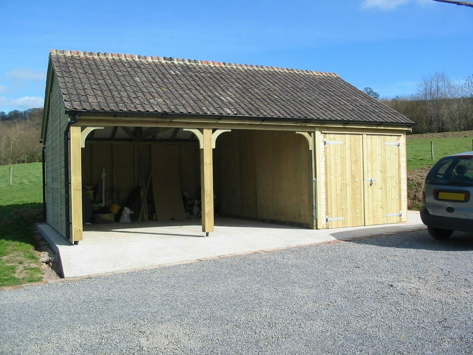 Timber carport and garage with terracotta roof
