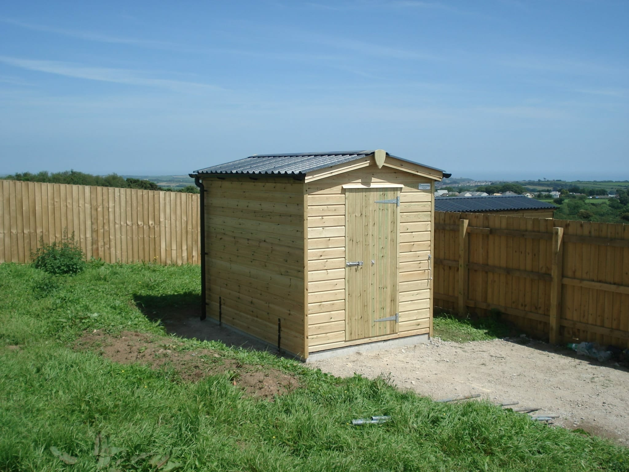 Small timber shed with apex roof and guttering