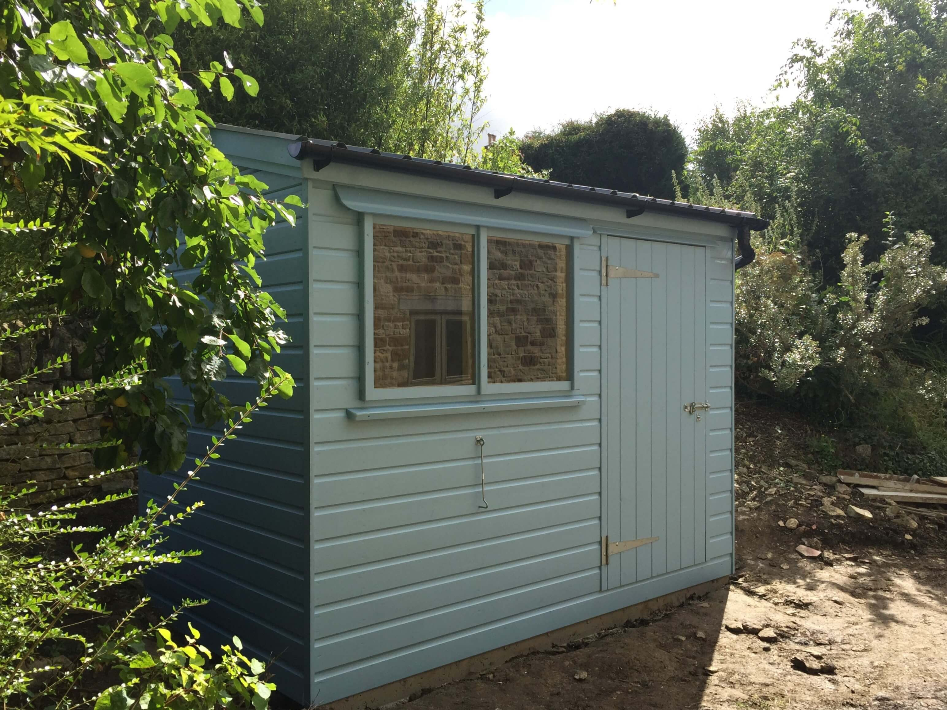 Painted garden shed lean to roof