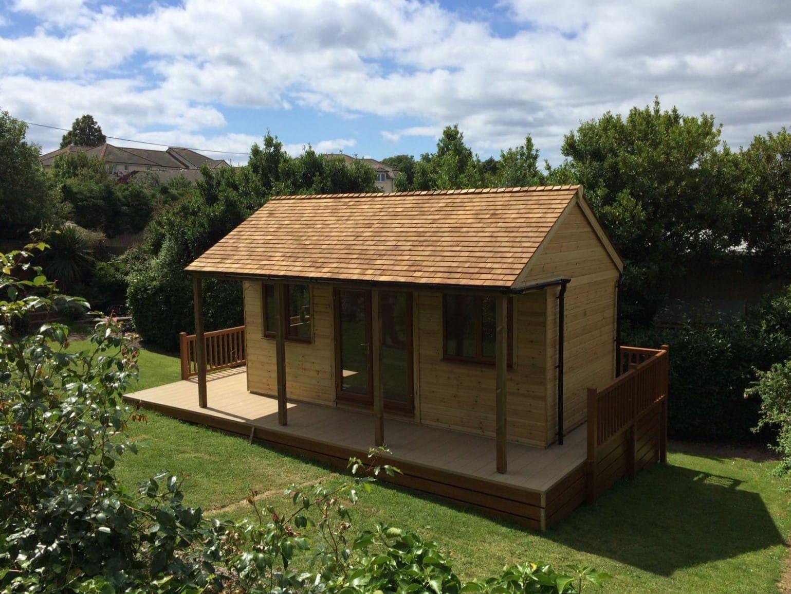 Summerhouse with wrap around decking