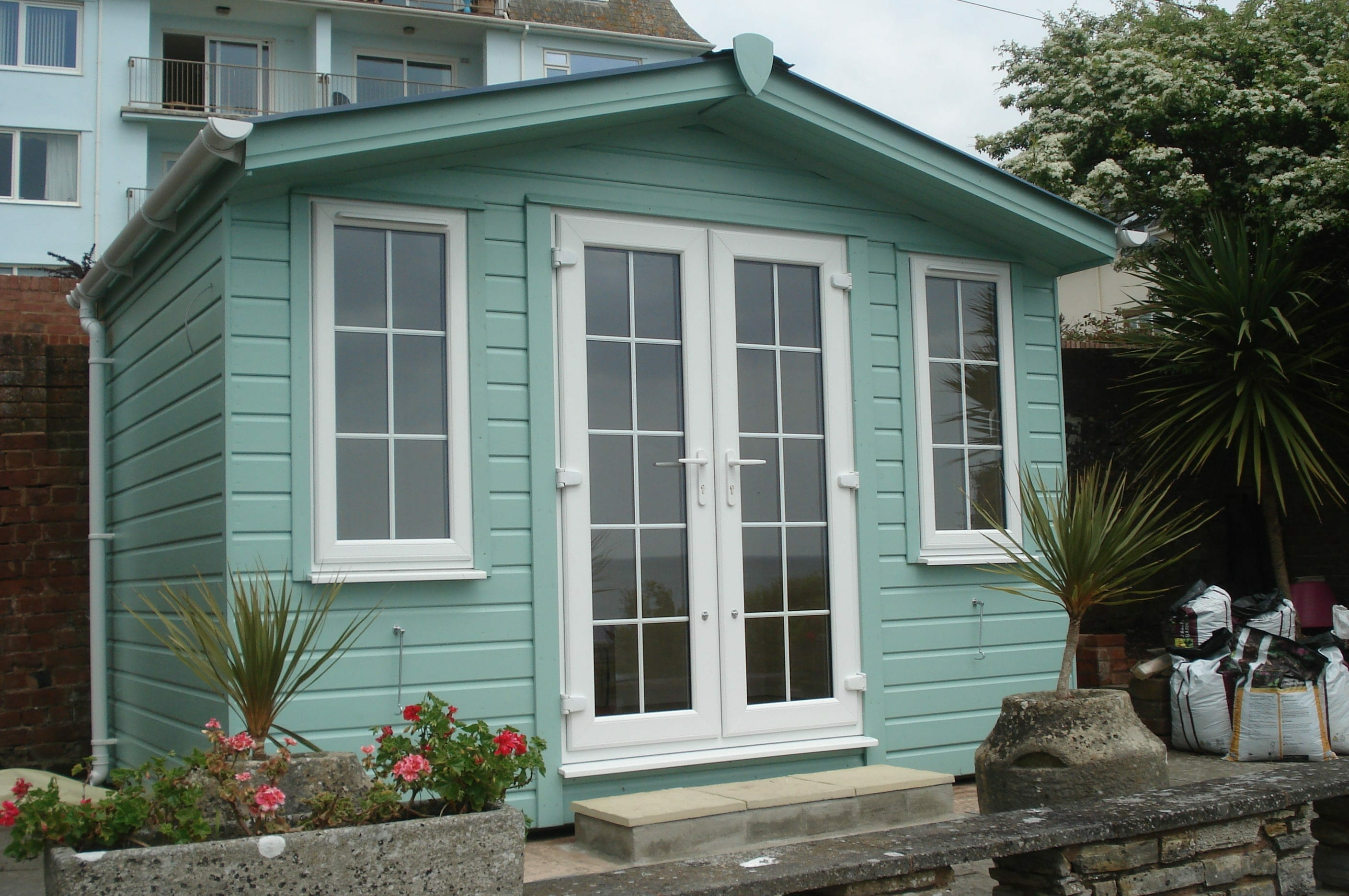 Green insulated summerhouse with french doors