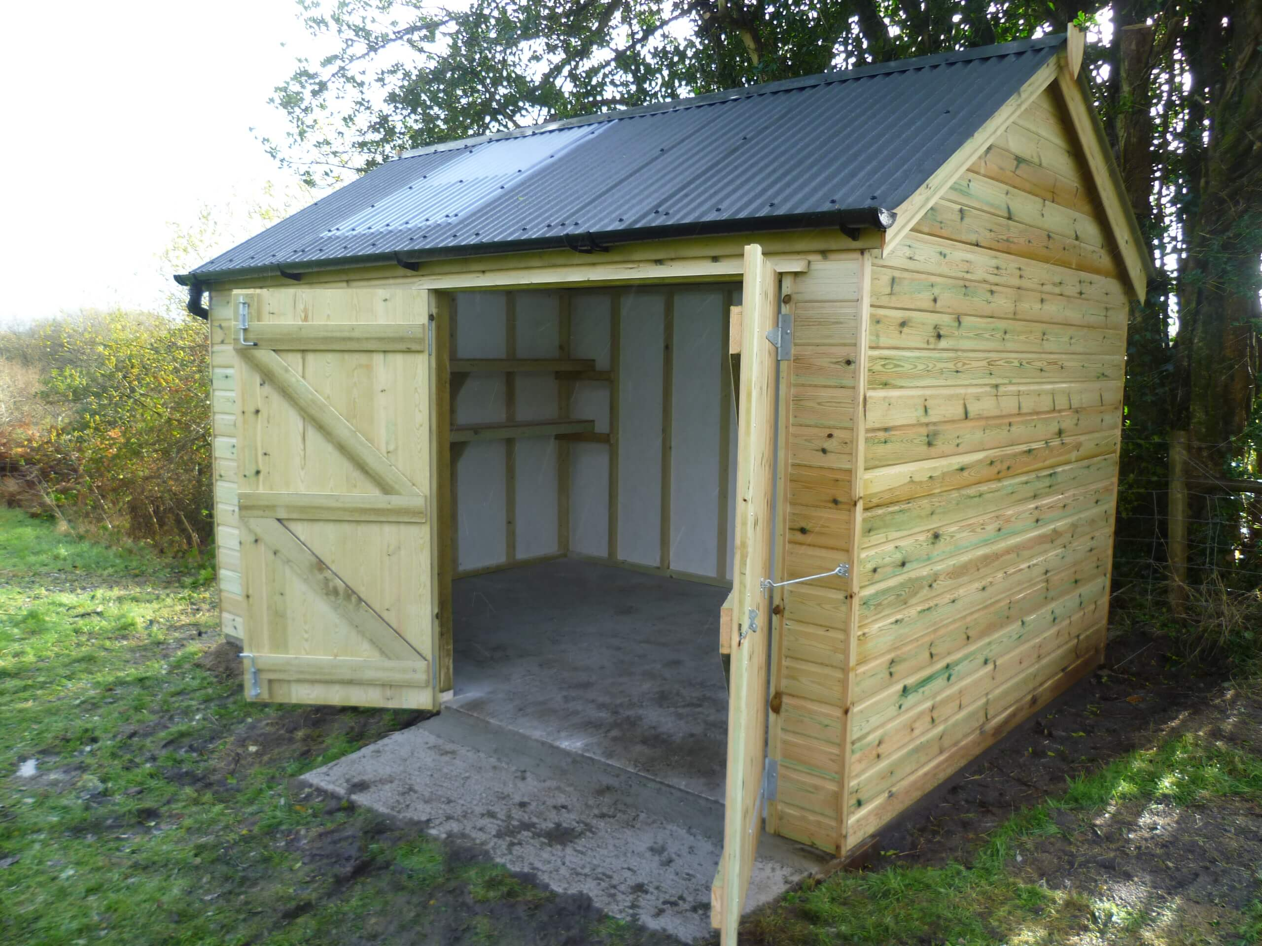 Apex shed with side opening doors and shelving