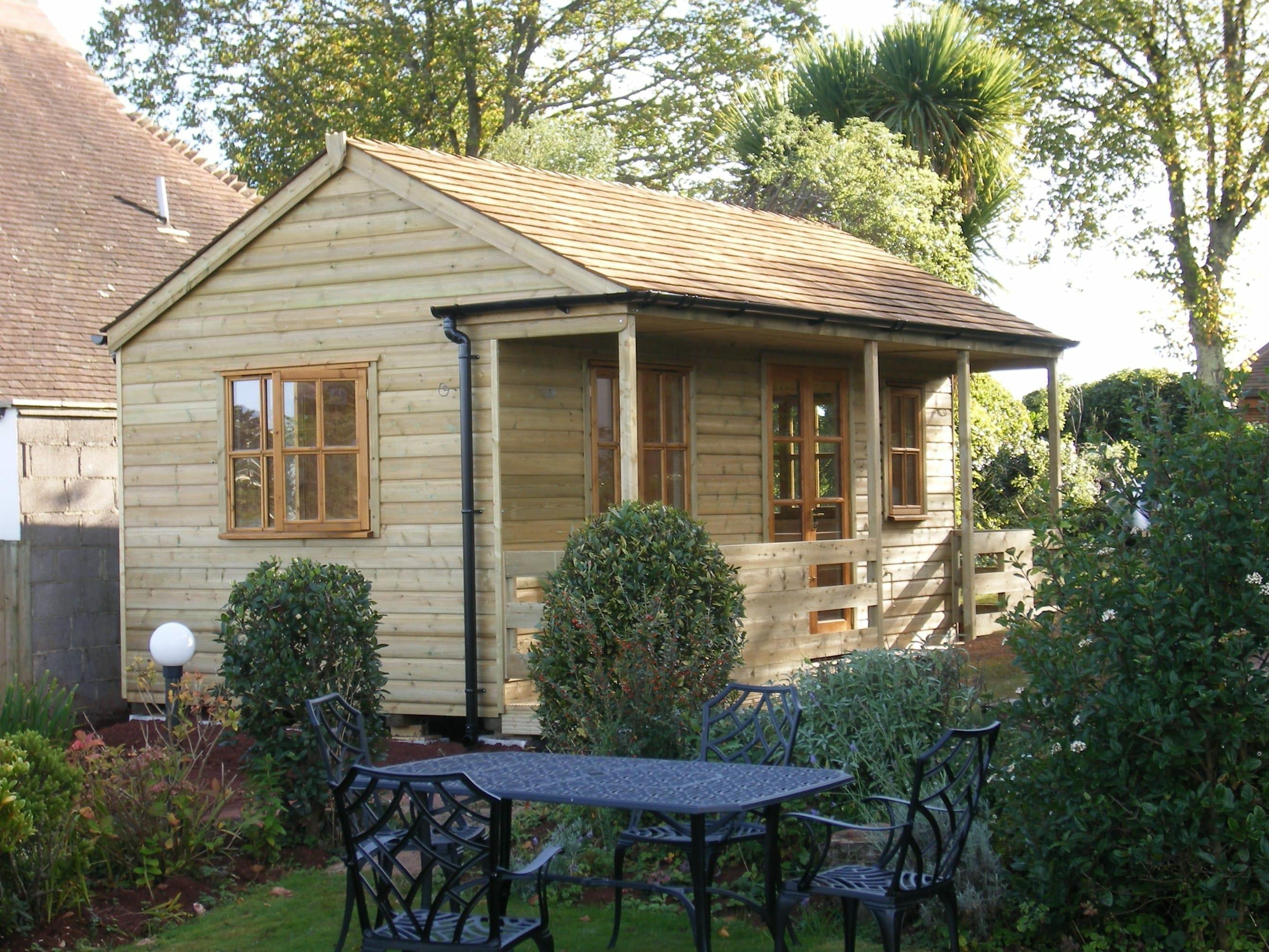 Cedar roofed summerhouse in Torquay garden