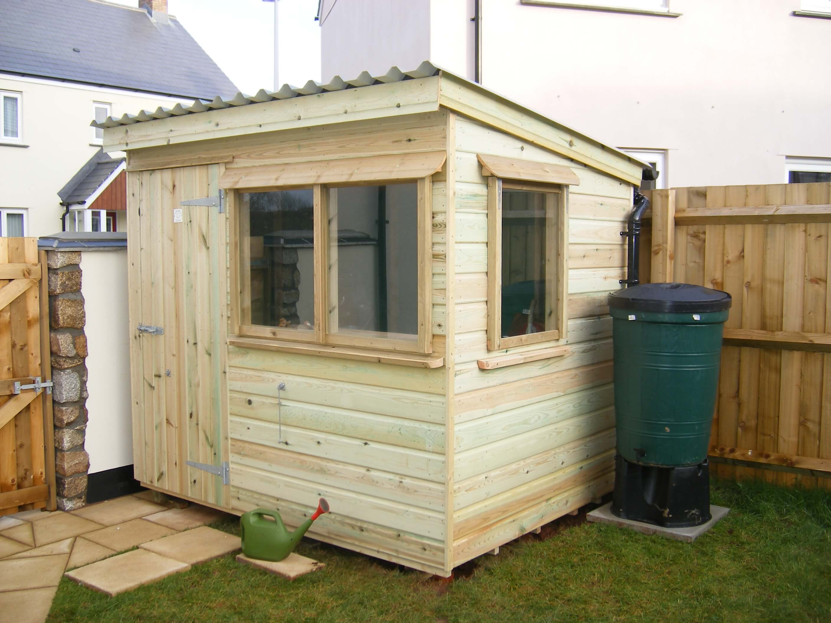 Bespoke garden shed with lean to roof and waterbutt