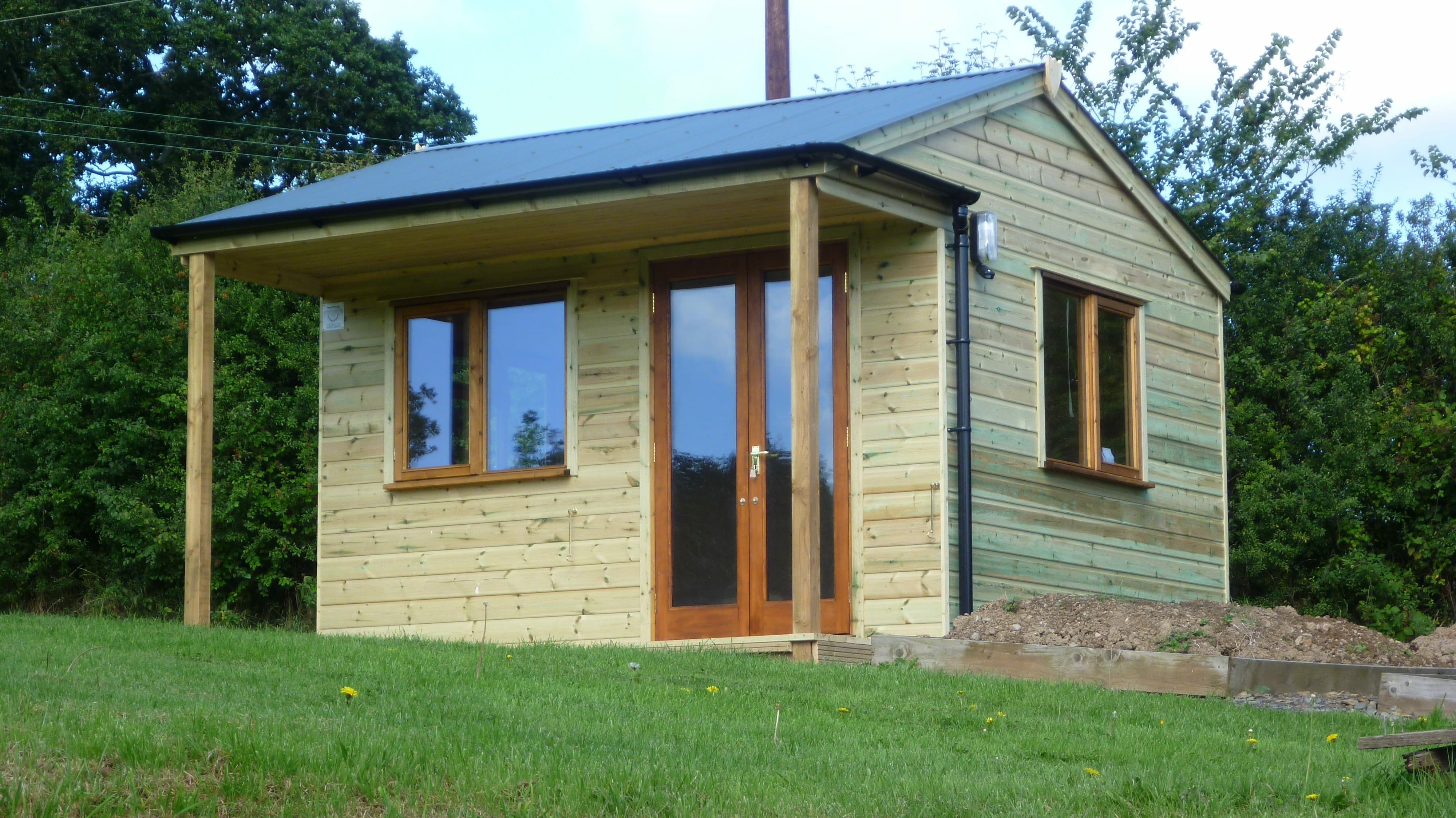 Garden building with double doors and veranda