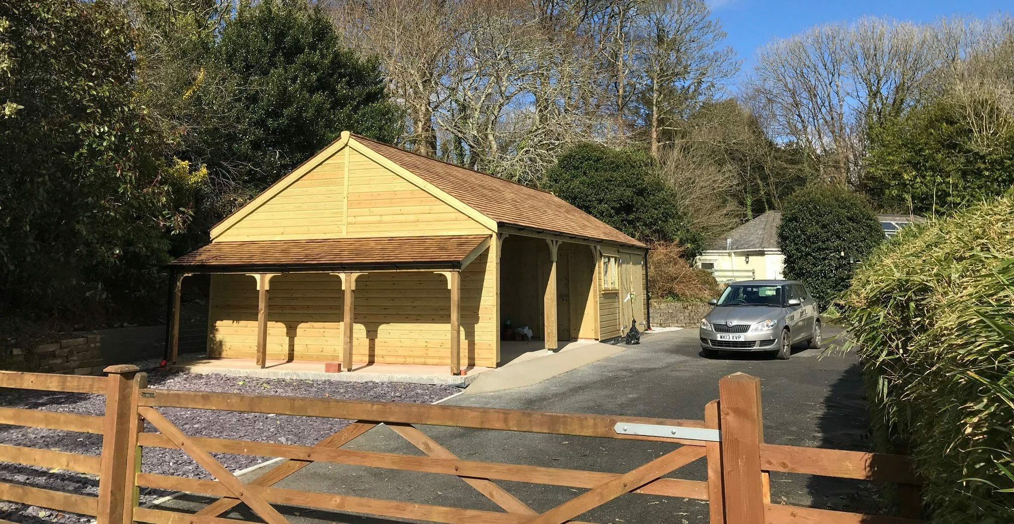 Combination timber garage with log store