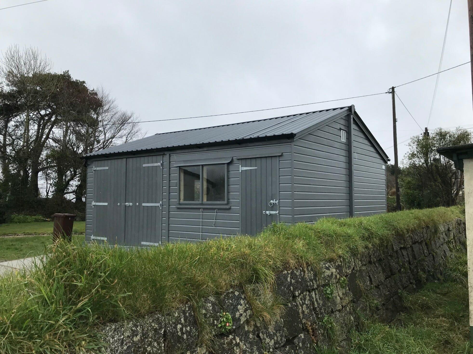 Painted garage with double doors and personnel door