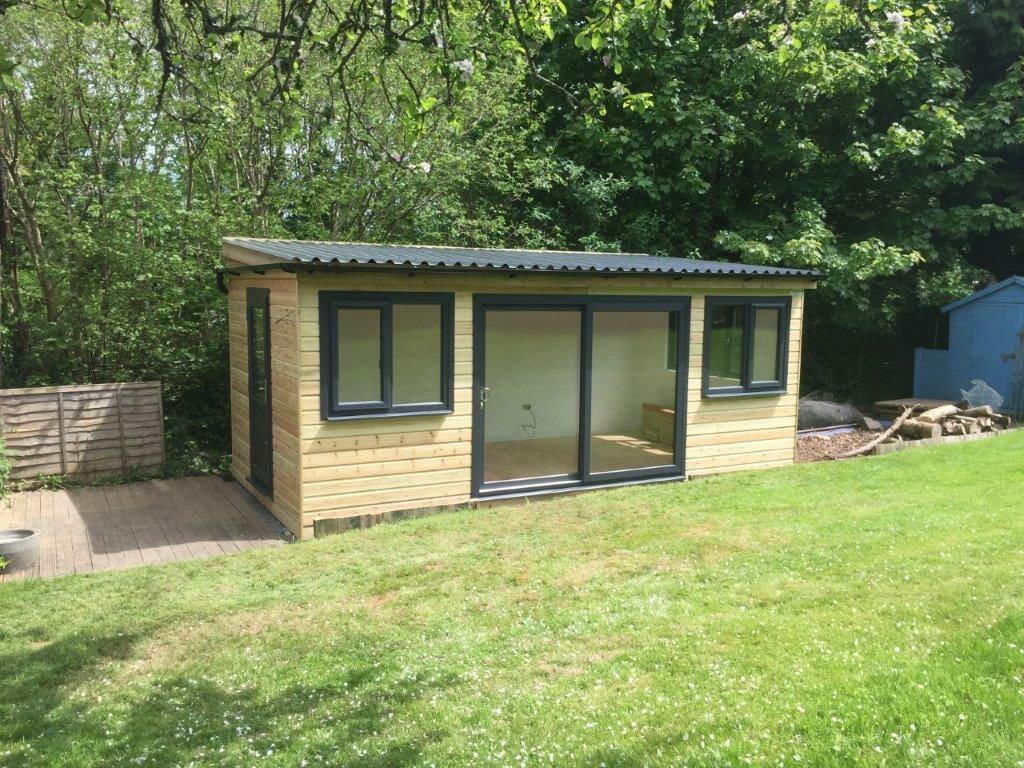 Pent roof timber garden office with wide patio doors
