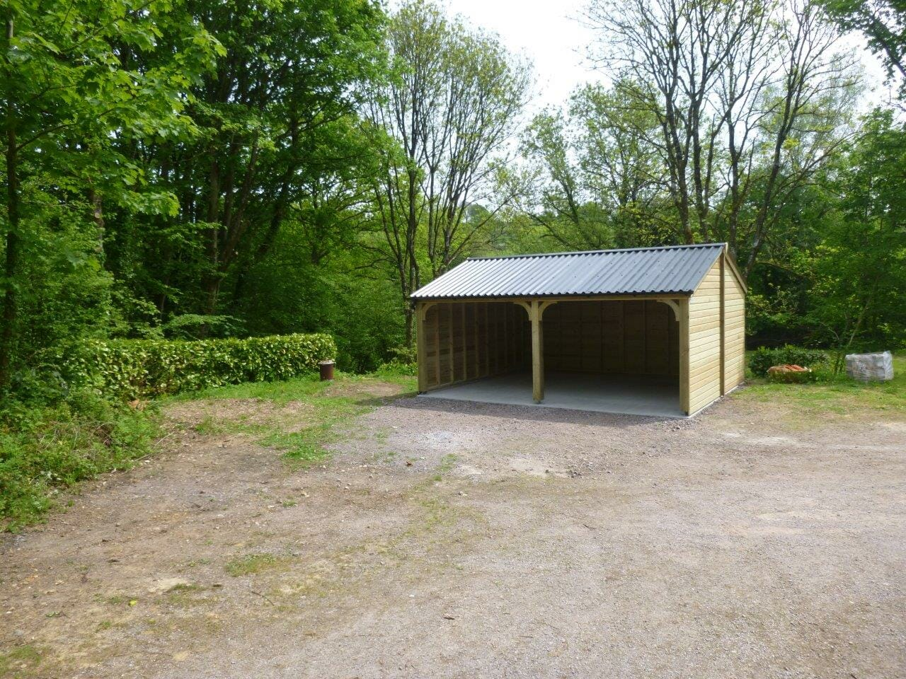 Double carport with robust plastisol steel roof