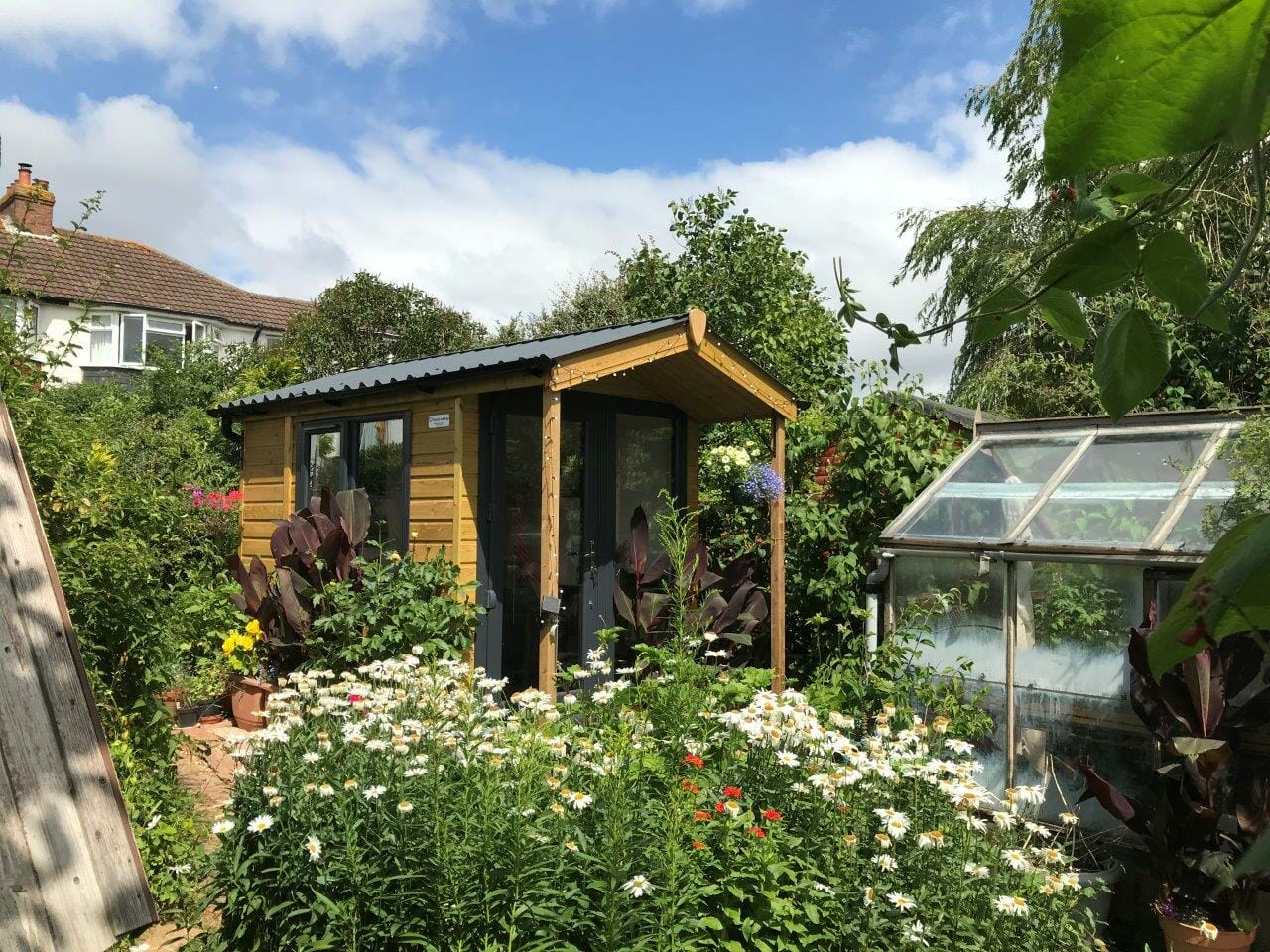 Artist studio with canopy in garden setting