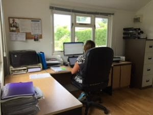Customer working in garden office